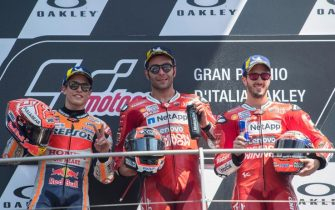 SCARPERIA, ITALY - JUNE 02: (L-R) Marc Marquez of Spain and Repsol Honda Team , Danilo Petrucci of Italy and Ducati Team and Andrea Dovizioso of Italy and Ducati Team  celebrate on the podium at the end of the MotoGP race during the MotoGp of Italy - Race at Mugello Circuit on June 02, 2019 in Scarperia, Italy. (Photo by Mirco Lazzari gp/Getty Images)