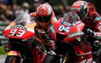 Repsol Honda Team's Spanish rider Marc Marquez (L) and Mission Winnow Ducati's Italian rider Andrea Dovizioso ride their motorbikes during the race of the Austrian Moto GP Grand Prix in Spielberg on August 11, 2019. (Photo by VLADIMIR SIMICEK / AFP)        (Photo credit should read VLADIMIR SIMICEK/AFP via Getty Images)