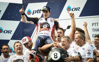 Repsol Honda Team Spanish rider Marc Marquez celebrates with his team on the podium after winning the MotoGP race for the Thailand Grand Prix at Buriram International Circuit in Buriram on October 6, 2019. (Photo by Lillian SUWANRUMPHA / AFP) (Photo by LILLIAN SUWANRUMPHA/AFP via Getty Images)