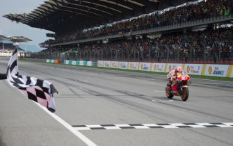 KUALA LUMPUR, MALAYSIA - NOVEMBER 03: Marc Marquez of Spain and Repsol Honda Team  cuts the finish lane during the MotoGP race during the MotoGP of Malaysia - Race at Sepang Circuit on November 03, 2019 in Kuala Lumpur, Malaysia. (Photo by Mirco Lazzari gp/Getty Images)