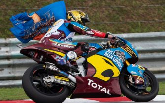 KUALA LUMPUR, MALAYSIA - NOVEMBER 03: Alex Marquez of Spain and EG 0,0 Marc VDS celebrates with flag  the second place and the Moto2 2019 Championship at the end of the Moto2 race during the MotoGP of Malaysia - Race at Sepang Circuit on November 03, 2019 in Kuala Lumpur, Malaysia. (Photo by Mirco Lazzari gp/Getty Images)