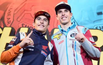 Repsol Honda Team's Spanish rider Marc Marquez (L) and his brother EG 0,0 Marc VDS's Spanish rider Alex Marquez pose during a press conference few hours before celebrating their MotoGP and Moto2 titles in Cervera on November 9, 2019. - Marc Marquez on October 6 sealed his sixth MotoGP title in Buriram, Thailand, while his brother Alex became Moto2 world champion on November 3 in the Malaysian city of Sepang. (Photo by JOSE JORDAN / AFP) (Photo by JOSE JORDAN/AFP via Getty Images)