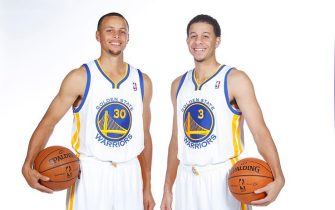OAKLAND, CA - SEPTEMBER 27:  Stephen Curry #30 and Seth Curry #3 pose for a photo on Golden State Warriors media day held September 27, 2013 at the Warriors practice facility in Oakland, California. NOTE TO USER: User expressly acknowledges and agrees that, by downloading and/or using this Photograph, user is consenting to the terms and conditions of the Getty Images License Agreement. Mandatory Copyright Notice: Copyright 2013 NBAE (Photo by Rocky Widner/NBAE via Getty Images)