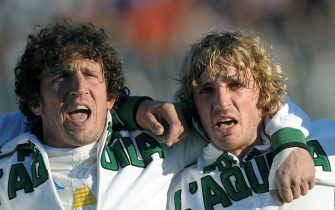 Italy's brothers Mauro (L) and Mirco Bergamasco sing their national song before their test match Italy vs Samoa in Del Duca stadium in Ascoli on November 28, 2009. AFP PHOTO / CHRISTOPHE SIMON (Photo credit should read CHRISTOPHE SIMON/AFP via Getty Images)