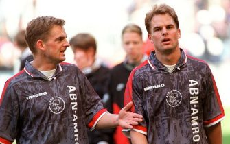 Filer dated 13 April 1997 of Dutch internationals Frank and Ronald (L) de Boer. Spanish Primera Division giants Barcelona have finally clinched the signature of the brothers after a protracted transfer saga. Barcelona are to pay Dutch club Ajax Amsterdam 22 million dollars for the pair confirmed the club on Friday. Barcelona offered 22 million dollars for both last year but Ajax refused to release the brothers from their contracts, which run until 2004. The pair launched a legal bid to get out of their contracts, claiming they would quadruple their salary at Barcelona, but this failed. This time Ajax agreed to the deal. (Photo credit should read KLUITERS/OUDENAARDEN/AFP via Getty Images)
