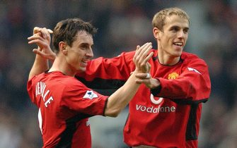 MANCHESTER, ENGLAND - DECEMBER 14:  Gary Neville and Phil Neville celebrate Man Utd's first goal of the match during the FA Barclaycard Premiership match between Manchester United v West Ham United at Old Trafford on December 7, 2002 in Manchester, England.  (Photo by John Peters/Manchester United via Getty Images)