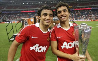 HOUSTON - JULY 28:  Rafael Da Silva (L) and Fabio Da Silva of Manchester United pose with the Allstar Trophy after the MLS Allstars match between Manchester United and the MLS Allstars at Reliant Stadium on July 28, 2010 in Houston, Texas.  (Photo by John Peters/Manchester United via Getty Images)