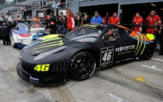 MONZA, ITALY - APRIL 13:  Valentino Rossi of team Team Kessel Racing - Ferrari 458 Italia drives out of the garage area during the Blancpain GT Endurance test day one at Autodromo di Monza on April 13, 2012 in Monza, Italy.  (Photo by Guido De Bortoli/Getty Images)