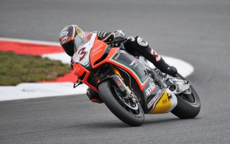 Italian rider of Aprilia, Max Biaggi, celebrates after winning for half a point the 2012 Superbike World Championship. Magny Cours, France, 7 October 2012. The closest ever finish in the history of the Superbike World Championship took place at Magny-Cours today when Max Biaggi (Aprilia Racing Team) finished the race fifth and in doing so he ended up the season 0.5 points ahead of Tom Sykes (Kawasaki Racing Team). Sykes did all he could in winning race two, while Biaggi did just enough by finishing fifth, the final points reading Biaggi 358 and Sykes 357.5. Jonathan Rea (Honda World Superbike Team) was second in the 23-lap race, with Sylvain Guintoli (PATA Racing Team Ducati) third. Biaggi's team-mate, Eugene Laverty was fourth in the race, but the other championship hopeful Marco Melandri (BMW Motorrad Motorsport) crashed out of contention. He finished third in the points in any case, on 328.5. This was Biaggi's second Superbike World Championship success, having won the title with Aprilia in 2010.  ANSA/FABRIZIO PORROZZI/UFFICIO STAMPA +++ NO SALES, EDITORIAL USE ONLY +++