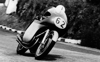 John Surtees racing an MV Agusta, 1958. He won the Junior and Senior Isle of Man TT races in this year, as well as winning the 500cc world championship for MV. He was the only man to ever win a World Drivers? Championship on two and four wheels. He competed in 15 TT races and finished in all except the 1956 Junior. At the end of the 1960 season, he decided to finish his motorcycling career and turned to four wheels, going on to win the F1 World Drivers Championship. (Photo by National Motor Museum/Heritage Images/Getty Images)