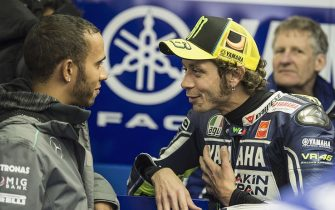 LE MANS, FRANCE - MAY 19:  Formula 1 driver Lewis Hamilton of Great Britain (L) speaks with Valentino Rossi of Italy and Yamaha Factory Racing before the MotoGP race during the MotoGP of France on May 19, 2013 in Le Mans, France.  (Photo by Mirco Lazzari gp/Getty Images)
