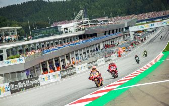 epa07768452 f.l.: Spanish MotoGP rider Marc Marquez of Repsol Honda Team Italian MotoGP rider Andrea Dovizioso of Ducati Team during th race for the MotoGP of Austria at the Red Bull Ring in Spielberg, Austria, on August 11, 2019.  EPA/DOMINIK ANGERER