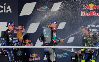 epa08566855 French MotoGP rider Fabio Quartararo (C), Petronas Yamaha SRT, celebrates on the podium after winning the race in Jerez-Angel Nieto circuit in Jerez de la Frontera, Spain, 26 July 2020, during the Motorcycling Grand Prix of Andalusia, next to Spanish Maverick Vinales (L), second placed, and Italian Valentino Rossi (R), third placed.  EPA/ROMAN RIOS