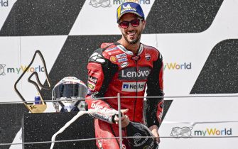 epa08607126 First placed Italian MotoGP rider Andrea Dovizioso of Ducati Team celebrates on the podium after the Motorcycling Grand Prix of Austria at the Red Bull Ring in Spielberg, Austria, 16 August 2020.  EPA/CHRISTIAN BRUNA