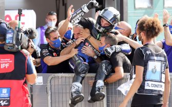 Spanish MotoGp rider Maverick Viñales of Monster Energy Yamaha MotoGP Moto celebrates with team'members after winning the motorcycling Grand Prix of San Marino at the Misano World Circuit Marco Simoncelli, Italy, 19 September 2020. ANSA/PASQUALE BOVE