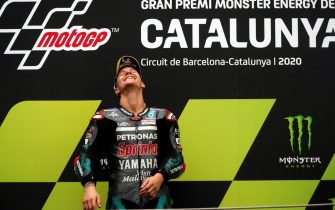 epa08701482 French MotoGP rider Fabio Quartararo of the Petronas Yamaha SRT team reacts on the podium after winning the Motorcycling Grand Prix of Catalonia at the Barcelona-Catalunya circuit in Montmelo, near Barcelona, Spain, 27 September 2020.  EPA/Alejandro Garcia