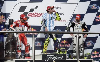 Italy's biker Valentino Rossi (C) of Yamaha celebrates on the podium after winning the Argentina Grand Prix at Termas de Rio Hondo circuit, in Santiago del Estero, on April 19, 2015 along with Italian Andrea Dovizioso (2-L) of Ducati, who came home second and British Carl Crutchlow (R) of Honda who came third. Valentino Rossi survived a late battle with defending world champion Marc Marquez, who crashed with two laps to go.  AFP PHOTO / JUAN MABROMATA        (Photo credit should read JUAN MABROMATA/AFP via Getty Images)