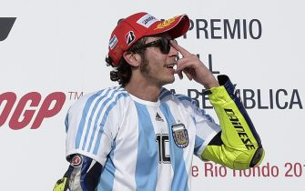 Italy's biker Valentino Rossi of Yamaha celebrates on the podium after winning the Argentina Grand Prix at Termas de Rio Hondo circuit, in Santiago del Estero, on April 19, 2015. Valentino Rossi survived a late battle with defending world champion Marc Marquez, who crashed with two laps to go.  AFP PHOTO / JUAN MABROMATA        (Photo credit should read JUAN MABROMATA/AFP via Getty Images)