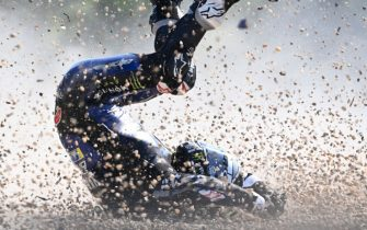 TOPSHOT - Monster Energy Yamaha's Spanish rider Maverick Vinales rolls on the ground after he crashed during the first training session ahead of the Moto GP Czech Grand Prix at Masaryk's circuit in Brno on August 7, 2020. (Photo by JOE KLAMAR / AFP) (Photo by JOE KLAMAR/AFP via Getty Images)