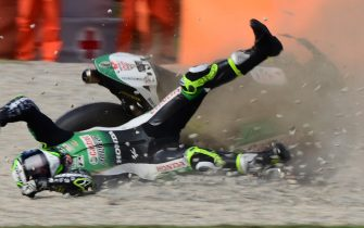 TOPSHOT - LCR Honda's British rider Cal Crutchlow crashes during the third MotoGP free practice session of the Moto Grand Prix de Catalunya at the Circuit de Catalunya on September 26, 2020 in Montmelo on the outskirts of Barcelona. (Photo by LLUIS GENE / AFP) (Photo by LLUIS GENE/AFP via Getty Images)