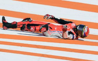 TOPSHOT - Reale Avintia Racing's Spanish rider Tito Rabat lays on the ground after crashing during the MotoGP race of the European Grand Prix at the Ricardo Tormo circuit in Valencia on November 8, 2020. (Photo by JOSE JORDAN / AFP) (Photo by JOSE JORDAN/AFP via Getty Images)