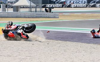 Pramac Racing's Italian rider Francesco Bagnaia rolls on the ground after he crashed during the Emilia Romagna MotoGP Grand Prix at the Misano World Circuit Marco Simoncelli on September 20, 2020. (Photo by ANDREAS SOLARO / AFP) (Photo by ANDREAS SOLARO/AFP via Getty Images)