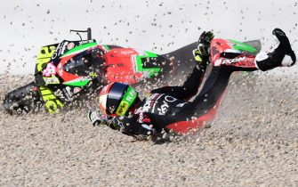 TOPSHOT - Aprilia Racing Team Gresini Spanish rider Aleix Espargaro crashes during the third MotoGP free practice session of the Moto Grand Prix de Catalunya at the Circuit de Catalunya on September 26, 2020 in Montmelo on the outskirts of Barcelona. (Photo by LLUIS GENE / AFP) (Photo by LLUIS GENE/AFP via Getty Images)
