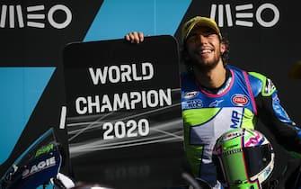 epa08835754 Italian Moto2 rider Enea Bastianini of Kalex celebrates awinning the Moto2 World Championship after the Motorcycling Grand Prix of Portugal at the Algarve International Circuit in Portimao, Portugal, 22 November 2020.  EPA/JOSE SENA GOULAO