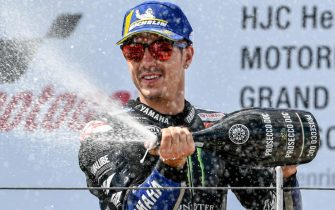 epa07701377 Second placed Spanish MotoGP rider Maverick Vinales of Monster Energy Yamaha Moto GP Team celebrates on the podium after the MotoGP race of the motorcycling Grand Prix of Germany at the Sachsenring racing circuit in Hohenstein-Ernstthal, Germany, 07 July 2019.  EPA/FILIP SINGER