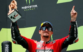 epa09250970 Australian MotoGP rider Jack Miller of the Ducati Lenovo team celebrates on the podium after taking the third place in the Motorcycling Grand Prix of Catalonia at the Barcelona-Catalunya circuit in Montmelo, near Barcelona, Spain, 06 June 2021.  EPA/Alejandro Garcia
