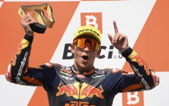 epa09415285 First placed Spanish Moto2 rider Raul Fernandez of Red Bull KTM Ajo celebrates on the podium during the Motorcycling Grand Prix of Austria at the Red Bull Ring in Spielberg, Austria, 15 August 2021.  EPA/CHRISTIAN BRUNA