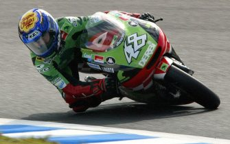 MOTEGI, JAPAN:  Spanish Grand Prix rider Jorge Lorenzo drives his Derbi during the 125cc class qualifying session of the Pacific Grand Prix at the Twin Ring circuit at Motegi, 04 October 2003. Lorenzo clocked the third fastest lap of 1 minute 58.662 seconds ahead of the 05 October finals.   AFP PHOTO/TOSHIFUMI KITAMURA  (Photo credit should read TOSHIFUMI KITAMURA/AFP via Getty Images)