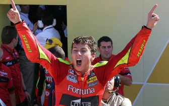 Cheste, SPAIN:  Spain's Jorge Lorenzo celebrates after winning the 250cc championship after the final race at the Valencia Grand Prix at the Ricardo Tormo racetrack in Cheste, 29 October 2006. San Marino's Alex de Angelis won with Italy's Roberto Locatelli in second and Spain's Hector Barbera in third. AFP PHOTO/JAVIER SORIANO  (Photo credit should read JAVIER SORIANO/AFP via Getty Images)