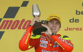 JEREZ, SPAIN:  Spanish Moto 250cc rider Jorge Lorenzo celebrates in Jerez 26 March 2006. Lorenzo won the race while Alex de Angelis of Republic of San Marino took the second position and Italian Andrea Dovizioso the third. AFP PHOTO/ PIERRE-PHILIPPE MARCOU  (Photo credit should read PIERRE-PHILIPPE MARCOU/AFP via Getty Images)