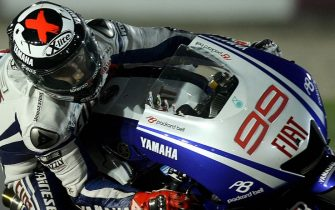 Jorge Lorenzo of Spain races to third place in the MotoGP event at the Qatar Grand Prix in Losail near Doha on April 13, 2009. Stoner, Australia's 2007 World MotoGP champion, won his third successive Qatar Grand Prix here in a race that had to be held over because of heavy rain. AFP PHOTO/KARIM JAAFAR (Photo credit should read KARIM JAAFAR/AFP via Getty Images)