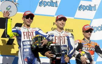 Winner Jorge Lorenzo (C) of Spain poses on the podium with second-placed Valentino Rossi of Italy (L) and third-placed Dani Pedrosa of Spain (R) after the final of the MotoGP Japanese Grand Prix at the Twin Ring Motegi circuit on April 26, 2009. Lorenzo, on a Yamaha, won the Japanese Grand Prix, besting teammate and defending world champion Valentino Rossi of Italy with a time of 43min 47.238sec.    AFP PHOTO / TOSHIFUMI KITAMURA (Photo credit should read TOSHIFUMI KITAMURA/AFP via Getty Images)