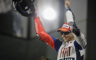 DOHA, QATAR - APRIL 11: Jorge Lorenzo of Spain and Fiat Yamaha celebrates on the podium after taking second place in the MotoGP of Qatar at the Losail Circuit on April 11, 2010 in Doha, Qatar. (Photo by Mirco Lazzari gp/Getty Images)