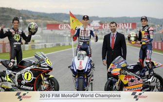 Spain's Prince Felipe (2-R) poses next to Gresini Racing Moto2 team's Spanish rider Toni Elias (L) Fiat Yamaha Team's Spanish rider Jorge Lorenzo (C) and Red Bull Ajo Motosport team's Spanish rider Marc Marquez (R) pose as World Champions 2010 at Valencia's MotoGP Grand Prix at Ricardo Tormo race track in Cheste near Valencia on November 7, 2010 . AFP PHOTO/JAVIER SORIANO. (Photo credit should read JAVIER SORIANO/AFP via Getty Images)
