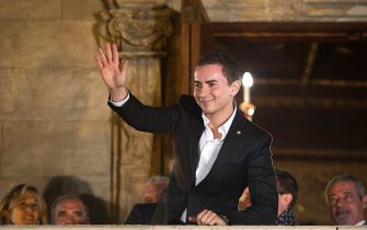 Moto GP world champion Spain's rider Jorge Lorenzo waves to the crowd from a balcony in Palma de Mallorca during a parade on November 19, 2012.   AFP PHOTO/ JAIME REINA        (Photo credit should read JAIME REINA/AFP via Getty Images)