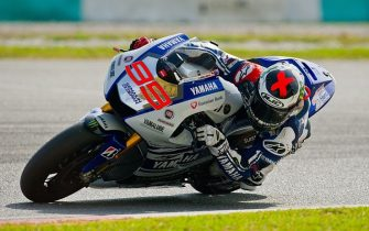 Yamaha Factory Racing's Spanish rider Jorge Lorenzo takes a corner during the first MotoGP pre-season testing session on the second day at the Sepang circuit outside Kuala Lumpur on February 5, 2014. AFP PHOTO / MOHD RASFAN        (Photo credit should read MOHD RASFAN/AFP via Getty Images)