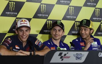Spain's Repsol Honda rider Marc Marquez (L), Movistar Yamaha MotoGP rider Jorge Lorenzo (C) and Movistar Yamaha MotoGP Italian rider Valentino Rossi give a press conference at the Catalunya racetrack in Montmelo, near Barcelona, on June 11, 2015, on eve of the Catalunya Moto GP Grand Prix training sessions. AFP PHOTO / JOSEP LAGO        (Photo credit should read JOSEP LAGO/AFP via Getty Images)
