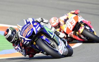 Repsol Honda's Spanish rider Marc Marquez (R) and Movistar Yamaha's Spanish rider Jorge Lorenzo ride during the MotoGP motorcycling race at the Valencia Grand Prix at Ricardo Tormo racetrack in Cheste, near Valencia on November 8, 2015.        AFP PHOTO / JAVIER SORIANO        (Photo credit should read JAVIER SORIANO/AFP via Getty Images)