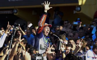 Movistar Yamaha's Spanish rider Jorge Lorenzo celebrates winning the race and the 2015 MotoGP world championship tiltle after the MotoGP motorcycling race at the Valencia Grand Prix at Ricardo Tormo racetrack in Cheste, near Valencia on November 8, 2015.   AFP PHOTO/ JAVIER SORIANO        (Photo credit should read JAVIER SORIANO/AFP via Getty Images)