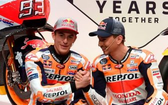 Repsol Honda Team's Spanish MotoGp riders Marc Marquez (L) and Jorge Lorenzo  attend the presentation of the new Repsol Honda team in Madrid on January 23, 2019. (Photo by PIERRE-PHILIPPE MARCOU / AFP)        (Photo credit should read PIERRE-PHILIPPE MARCOU/AFP via Getty Images)