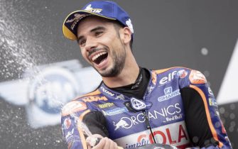 epa08619755 First placed Portuguese MotoGP rider Miguel Oliveira of Red Bull KTM Tech 3 celebrates on the podium after the Motorcycling Grand Prix of Styria at the Red Bull Ring in Spielberg, Austria, 23 August 2020.  EPA/CHRISTIAN BRUNA