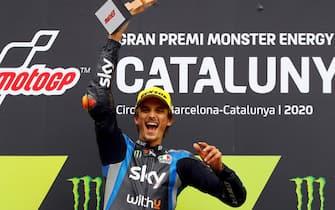 epa08701130 Italian Moto2 rider Luca Marini of the Sky Racing team celebrates on the podium after winning the Moto2 race of the Motorcycling Grand Prix of Catalonia at the Barcelona-Catalunya circuit in Montmelo, near Barcelona, Spain, 27 September 2020.  EPA/Alejandro Garcia
