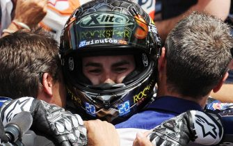 Spanish Moto GP rider Jorge Lorenzo of Yamaha Factory Racing, celebrates his victory after the Moto GP race of the Italian motorcycling Grand Prix at Mugello circuit, central Italy, 15 July 2012. ANSA/ CARLO FERRARO