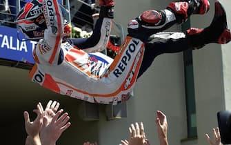 Spanish rider Marc Marquez of Honda Repsol team celebrates his victory after the MotoGP race of the Grand Prix of Italy, at the Mugello circuit, Scarperia, central Italy, 01 June 2014  ANSA/ CLAUDIO ONORATI