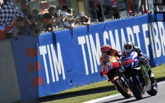 Spanish MotoGP rider Jorge Lorenzo (R) of the Movistar Yamaha  is on his way to win the Motorcycling Grand Prix of Italy at the Mugello circuit in Scarperia, central Italy, 22 May 2016.  Follow Spanish Moto GP rider Marc Marquez (L) of Repsol Honda Team finished in second place.  ANSA/CLAUDIO ONORATI