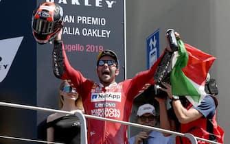 Italian Moto GP rider Danilo Petrucci of Ducati Team celebrates on the podium after winning  the Motorcycling Grand Prix of Italy at the Mugello circuit in Scarperia, central Italy, 2 June 2019 ANSA/CLAUDIO GIOVANNINI